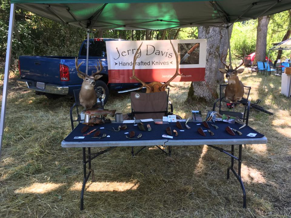 JDKnives booth at Traditional Archery 7-2017 license blurred