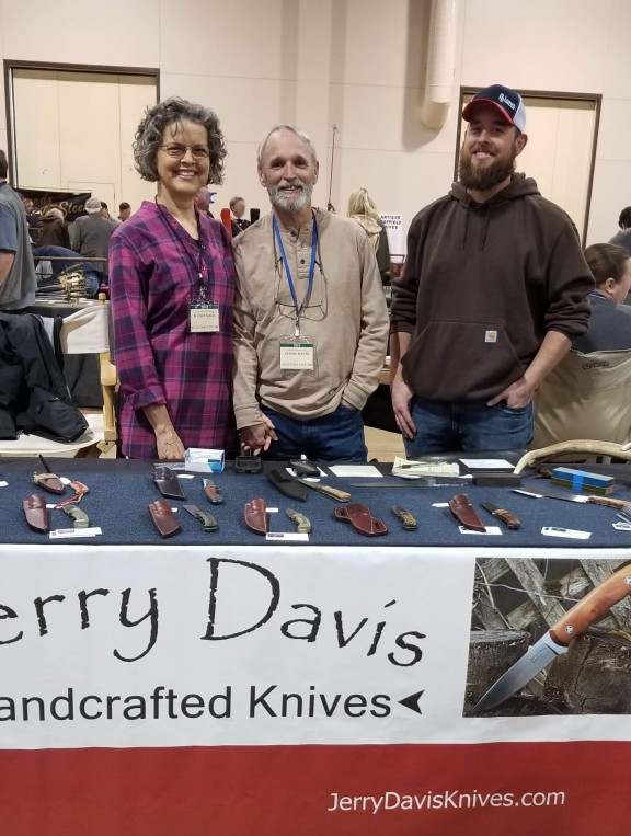 Jerry Davis at his table at the knife show with wife and son in Eugene Oregon with his wife Kathy and son Seth April 2019